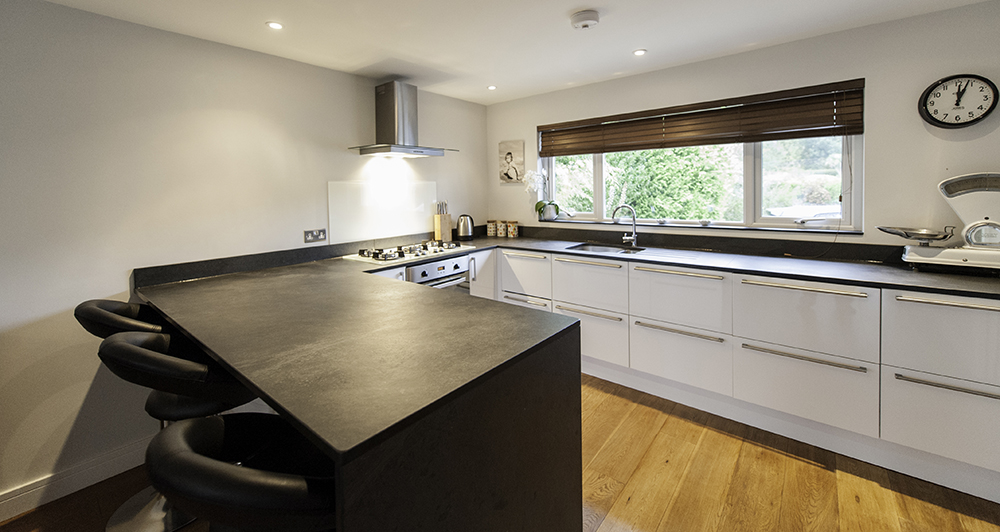 open plan kitchen with slate worktop