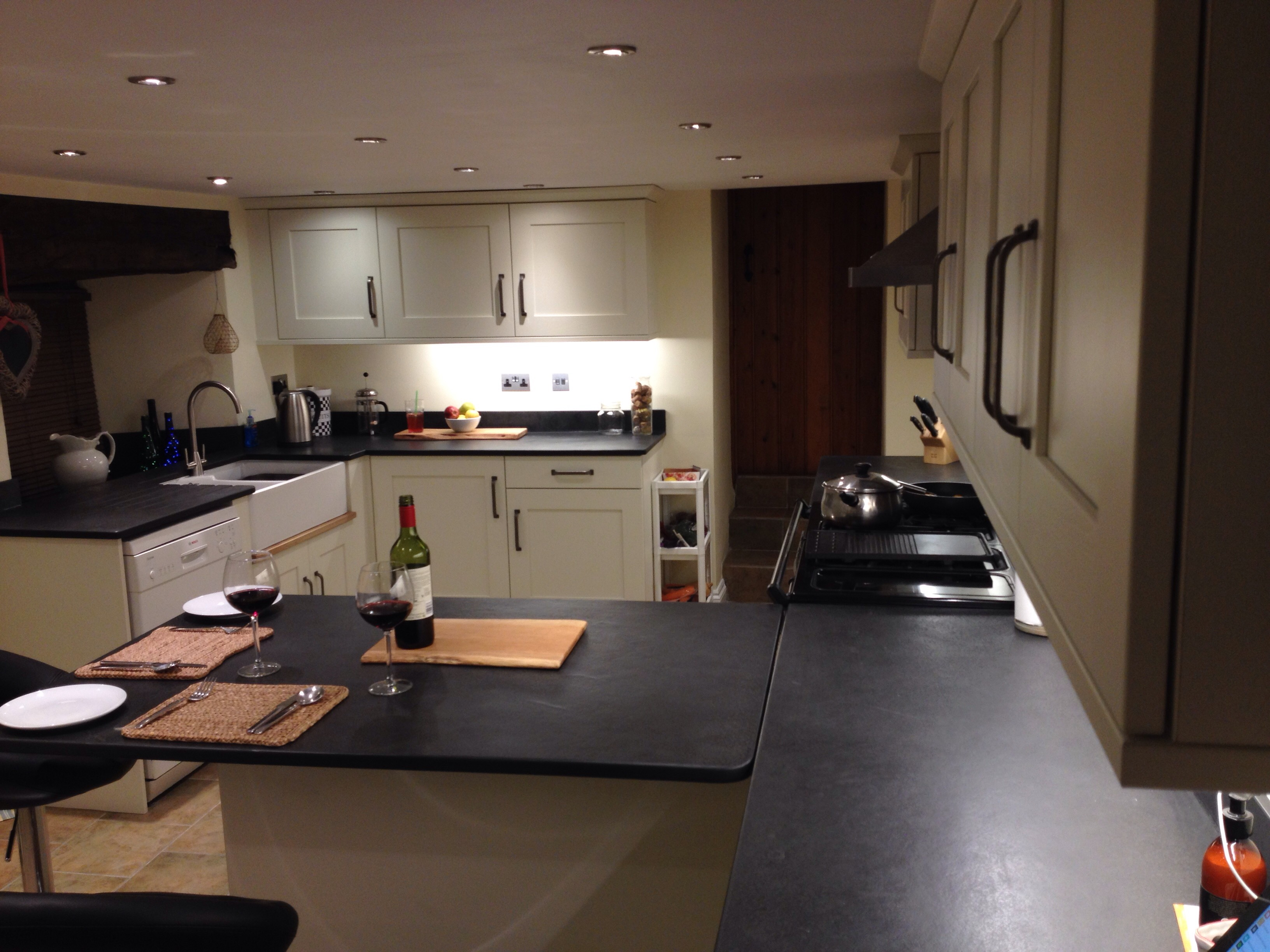 Full Breakfast Bar And Kitchen Surfaces In Slate