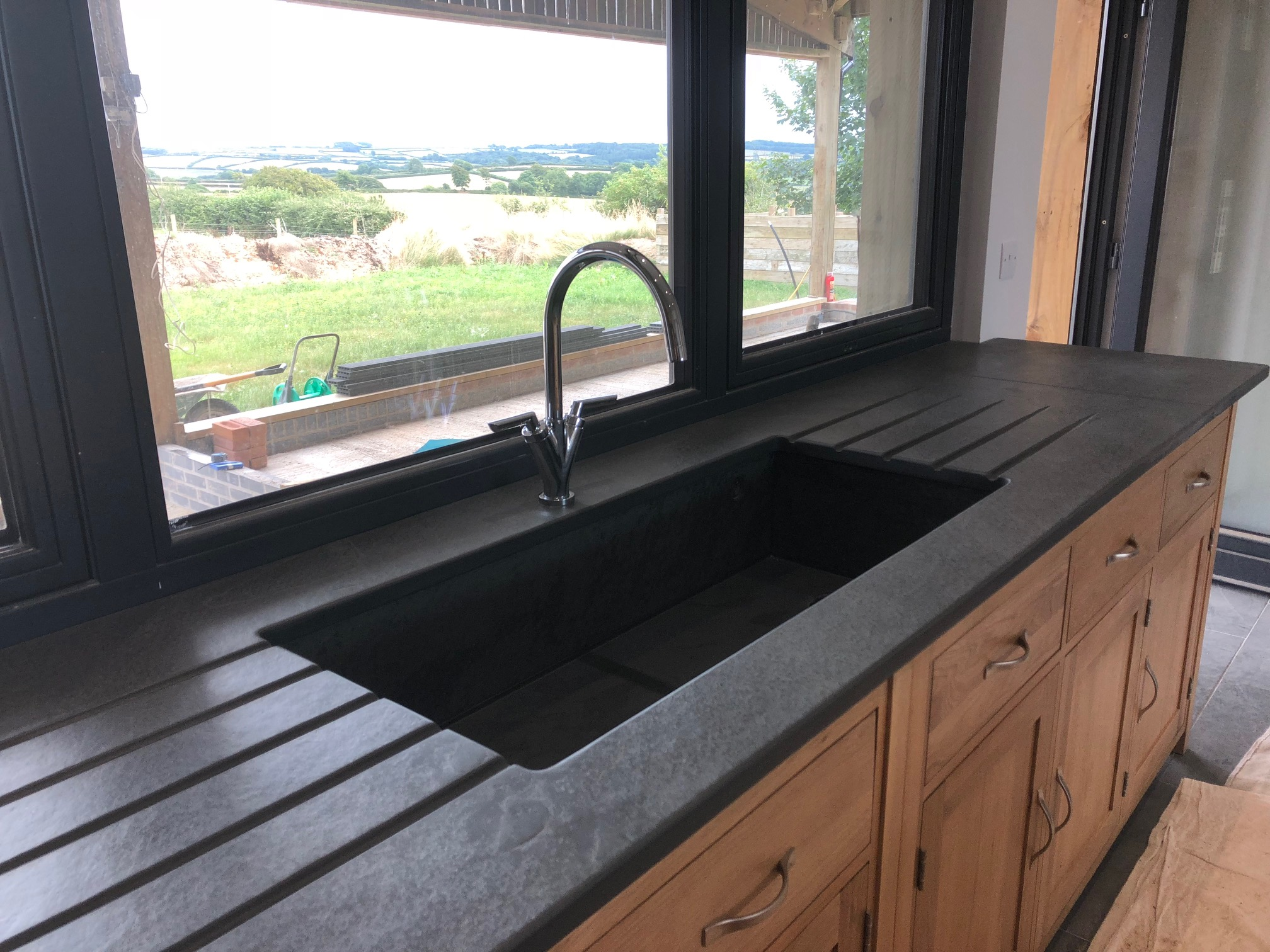 Picture of: Natural Slate Stone Sink Surrounds And Grooved Draining Boards