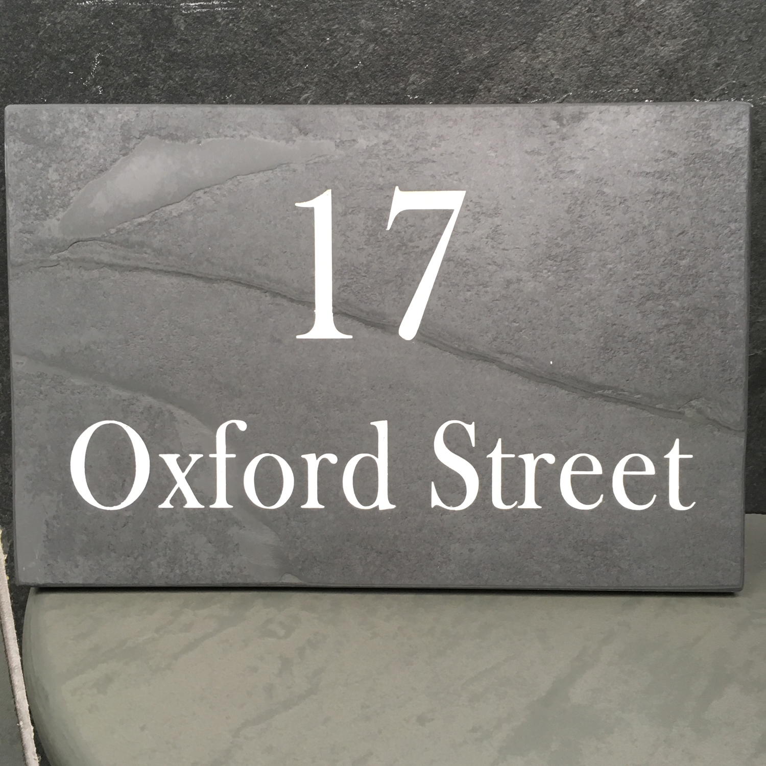 Engraved sign for house number and street name