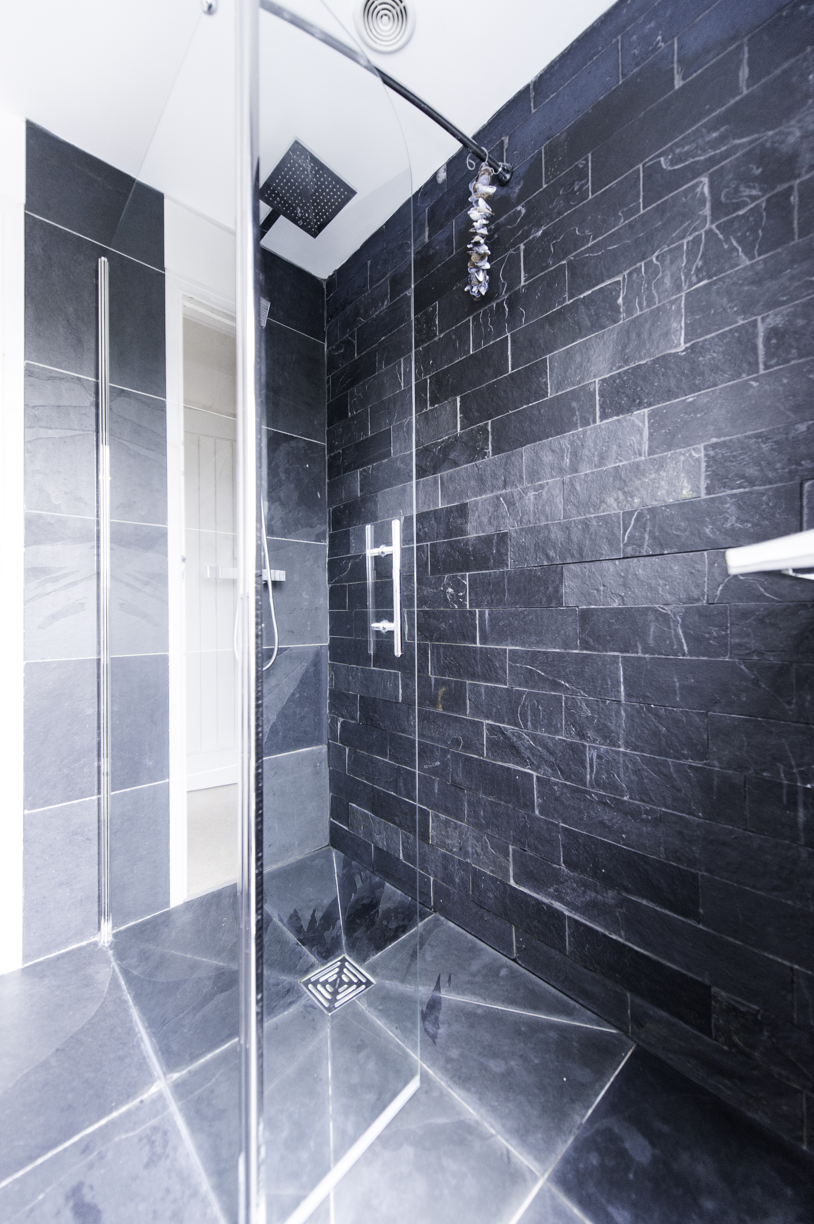 Modern Glass Shower With Rough Wall Tiles Cut From Slate