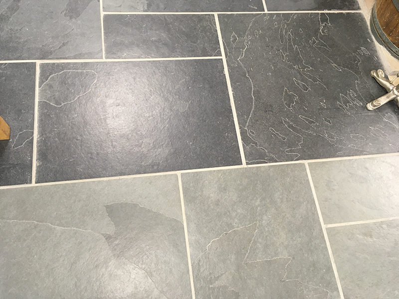Graphite coloured slate and blue/grey coloured slate side by side