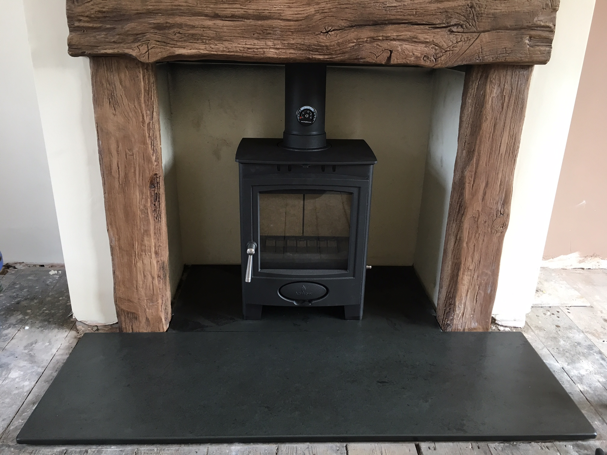 traditional wood burner on a slate hearth