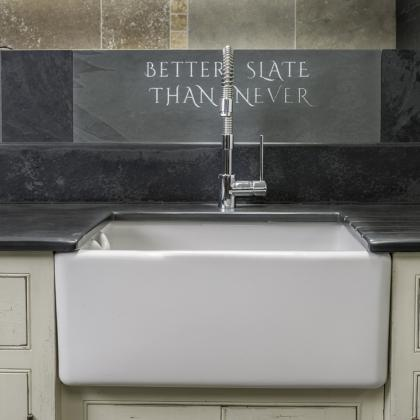 Beautiful Belfast sink with an engraved slate backsplash custom made by Ardosia
