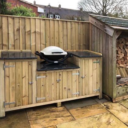 slate worktops on a custom wooden barbecue