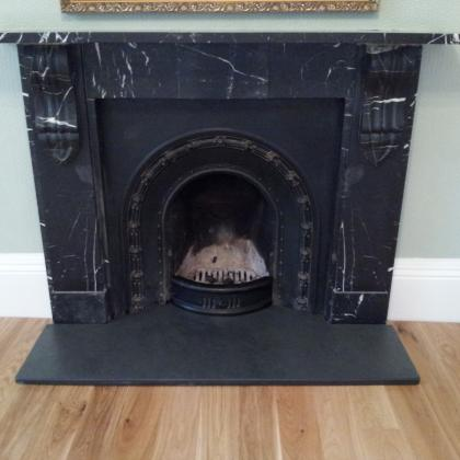 Black fire place with a black Brazilian slate fire hearth