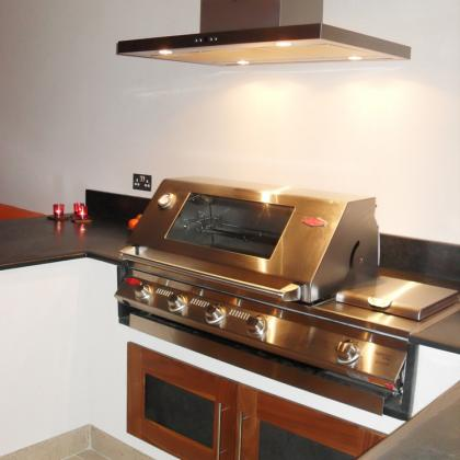Commercial kitchen with inbuilt slate worktops surrounding the ovens