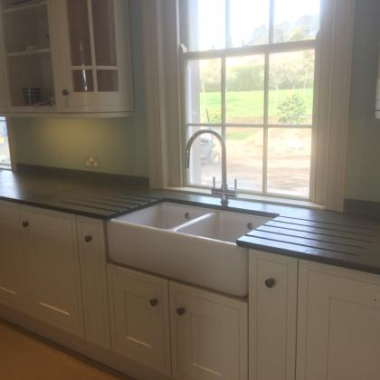 Country kitchen with slate sink worktop