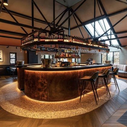 Central bar area in a restaurant with a bar worktop made from Ardosia Slate