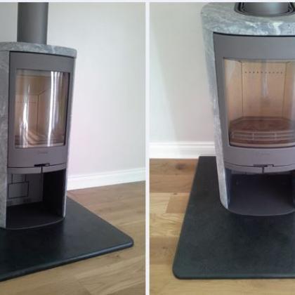 Black slate fire hearth for a modern woodburner