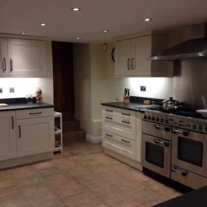 Double range oven with slate work surfaces in a modern kitchen