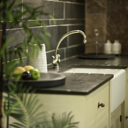 Kitchen sink with landscape patterned slate wall tiles