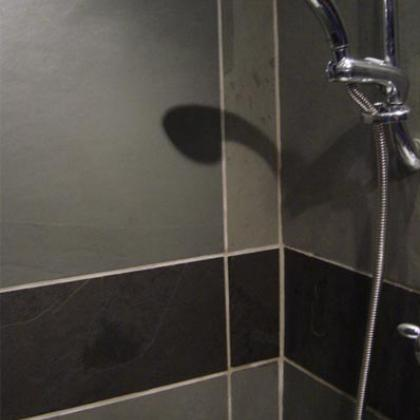 Slate shower wall tiles in grey and black