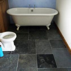 Small bathroom with slate flooring