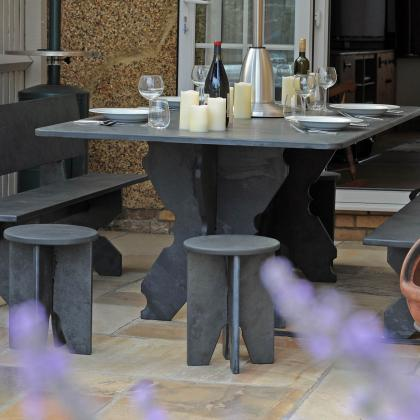 Stools and benches with table in slate