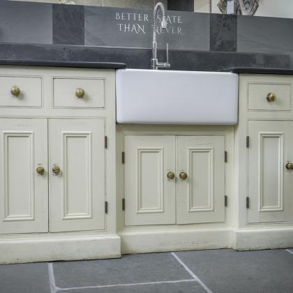 Cottage kitchen sink, slate worktop and wooden storage cupboards