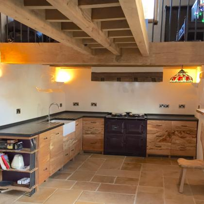 Designer home with in built aga set around a slate kitchen work surface