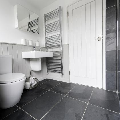 Modern designer bathroom with clean lines and slate floor tiles