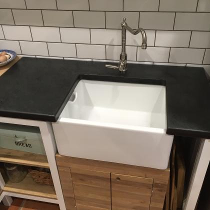 Belfast sink, vanity unit underneath with a slate sink worktop