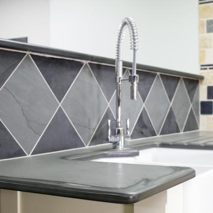 Beautiful diamond pattern slate wall tiles for a Belfast sink backsplash.