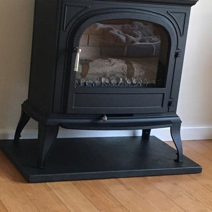 modern woodburner on stone hearth