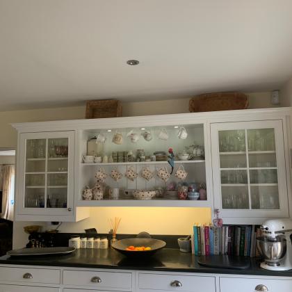 Lit slate worktop in a white kitchen