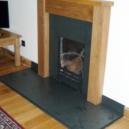 Light Oak Surround with Brazilian Black Slate Back Panel and Hearth