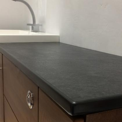 Dark grey surround with sunken sink from Ardosia