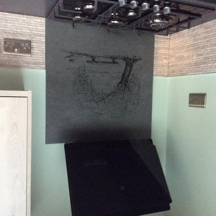 Cooker splashback in slate with engraving