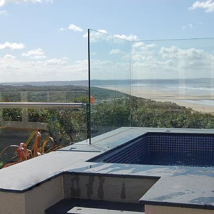Slate coping with glass backing overlooking beach