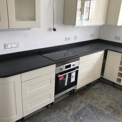 Electric induction hob with a hand cut oven surround in slate