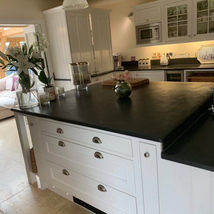 Stunning modern kitchen breakfast island with a slate worktop on two levels