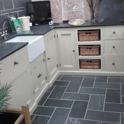 Slate tiles in a country kitchen in L shaped pattern
