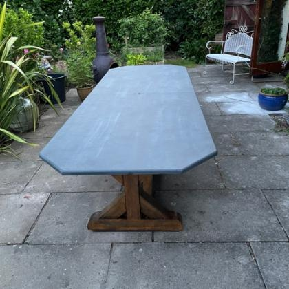 Long slate table suitable for outdoor use