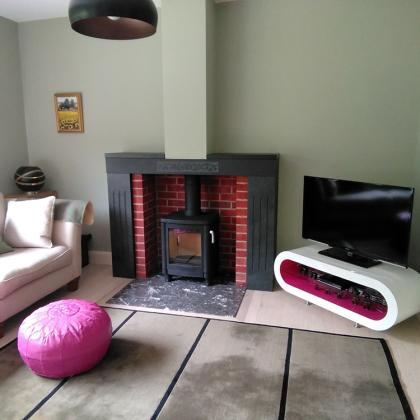 marble hearth in a lounge with a slate surround and mantle