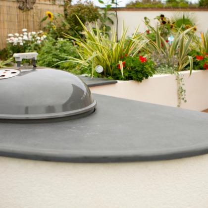 Outdoor BBQ with slate worktop surround