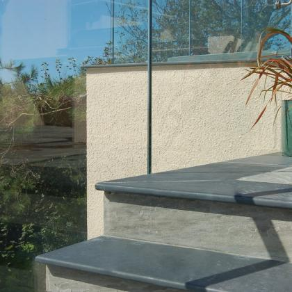 Outdoor swimming pool with stairs in slate