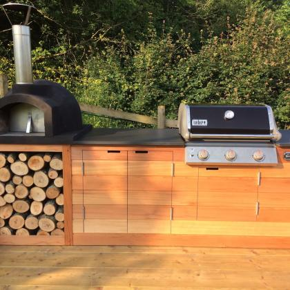 Barbecue and pizza oven, custom made with slate work surface