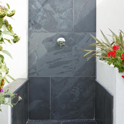 Slate shower in  garden, perfect after going to the beach