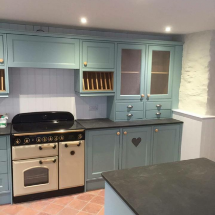 pastel colour country kitchen with natural stone worktop