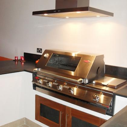 slate BBQ tops over cabinet with slate and walnut doors