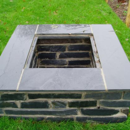Slate topped square garden well