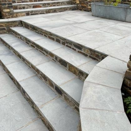 slate flagstones and wall capping in a garden