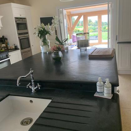 Kitchen island slate worktop with mebedded Belfast sink