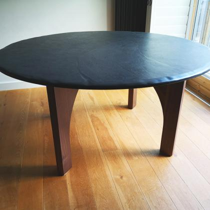 Round table with slate top and wooden legs