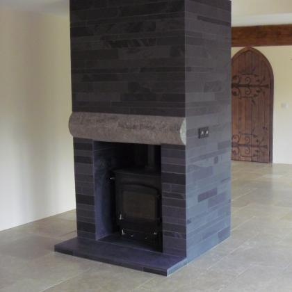 Focal point for a room with a slate pillar made from pieces of cut slate stone