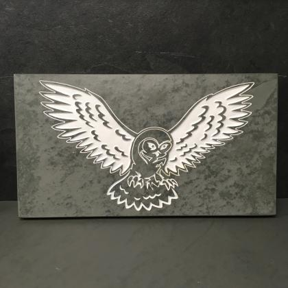Image of an owl engraved on slate