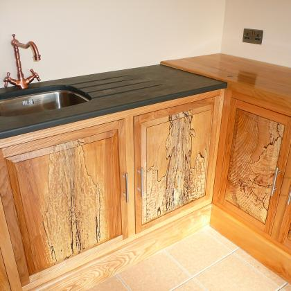 wooden units and slate sink surround