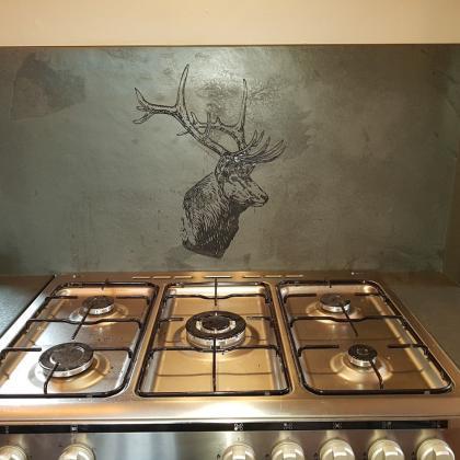 Slate cooker splash back engraved with a stag