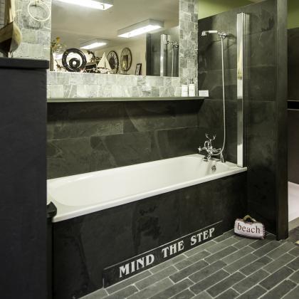 Slate tiled bath with a shower over the bath